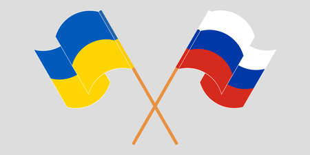 Crossed and waving flags of the Ukraine and Russia