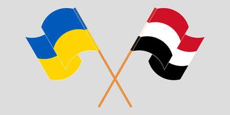 Crossed and waving flags of Ukraine and Yemen