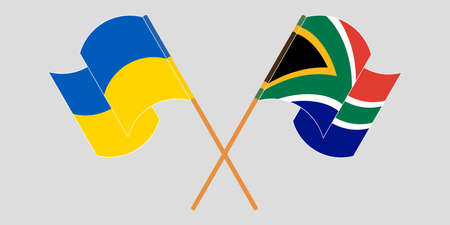 Crossed and waving flags of Ukraine and Republic of South Africa