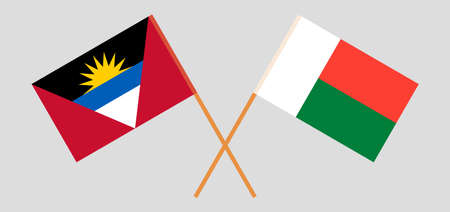 Crossed flags of Antigua and Barbuda and Madagascar
