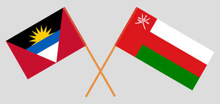 Crossed flags of Oman and Antigua and Barbuda