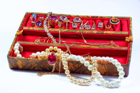 Open Jewelry Box With Jewels Over White Background Stock Photo