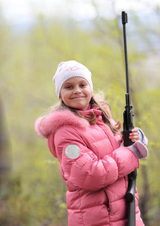 little smiling girl with sport gun photo