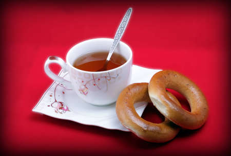 bublik: a Cup of tea on a saucer with two delicious bagels