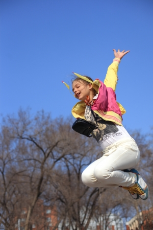 beaty: young beaty sport dressed girl jumping in air
