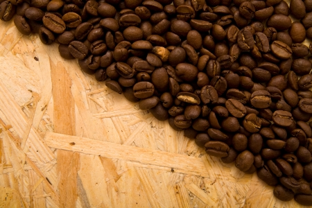 grains of coffee on a wooden background  Stock Photo - 13818297
