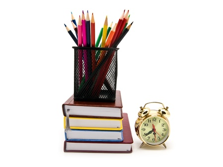 books, clock and pencils on a white background Stock Photo - 13857580
