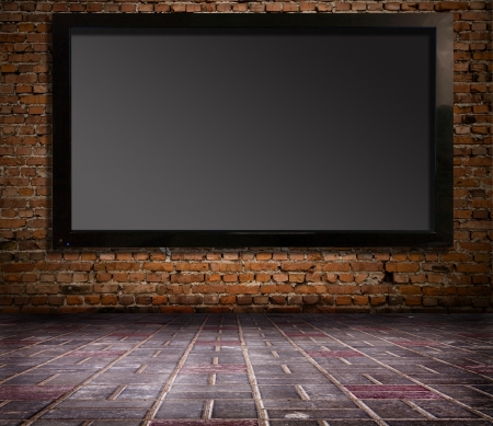 definitions: interior with a television set on an old wall Stock Photo