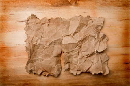 old paper on a wooden background  photo