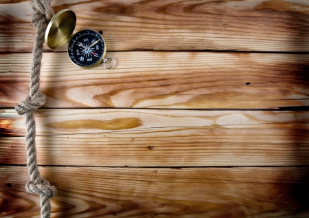 compass on a wooden background photo