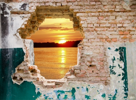 blue sky in a hole on a background an old wall Stock Photo - 15525957
