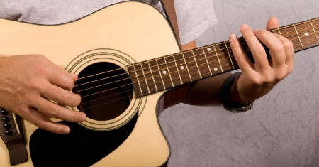 a man playing on a guitar photo