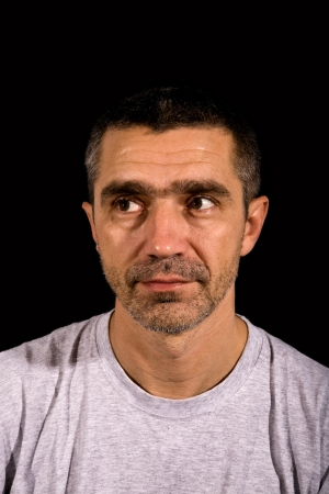 portrait of man on a black background