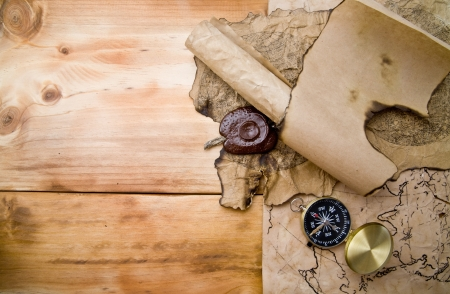 map and compass on a wooden background  Stock Photo - 15394229