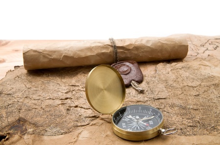 old maps and compass on a white background   photo