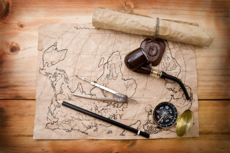 map and compass on a wooden background