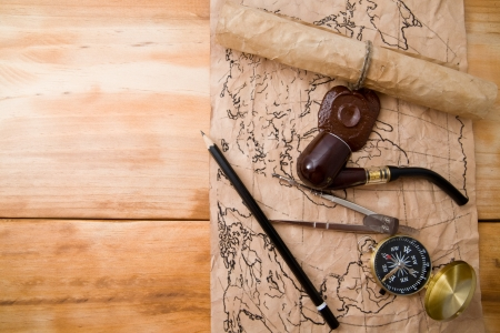 map and compass on a wooden background  Stock Photo - 15394194