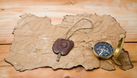 old paper and compass on a wooden background