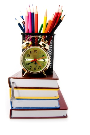 books, clock and pencils on a white background Stock Photo - 15401617