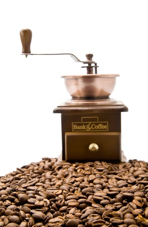 coffee grinder and coffee on a white background