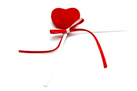 red heart with a bow on a white background
