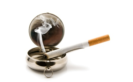 cigarette in an ash-tray on a white background