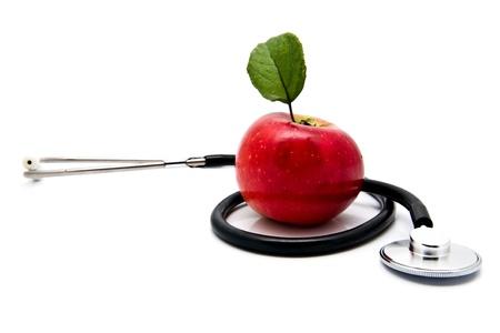 stetoskop: apple and stetoskop on a white background