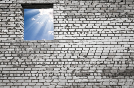 blue sky in a hole on a background an old wall Stock Photo - 15405102