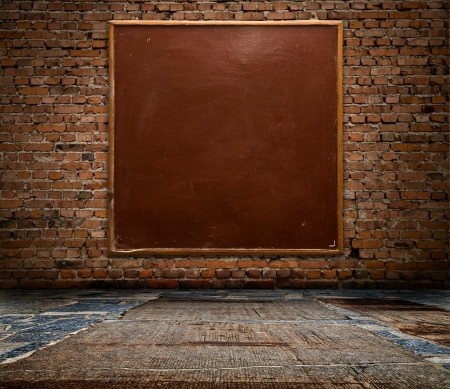 school board on a brick wall Stock Photo - 15404072