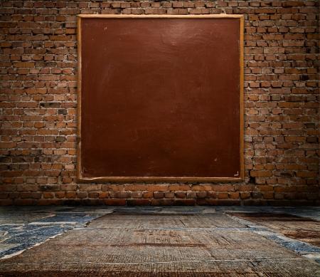 school board on a brick wall Stock Photo - 15404072