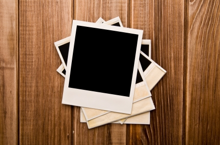 old photos on a wooden background Stock Photo - 15404013