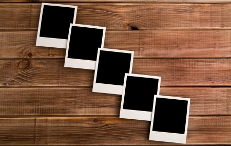 old photos on a wooden background  Stock Photo - 15404011