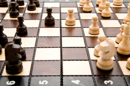 chellange: chess figures on a playing board