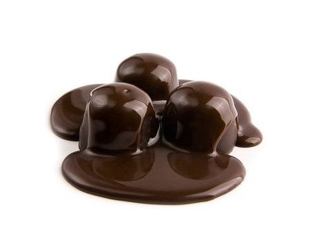 candys in a chocolate on a white background  Stock Photo