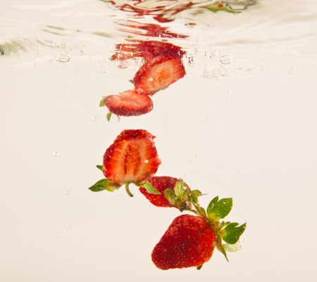 strawberry in clear water on a white background Stock Photo - 15535571
