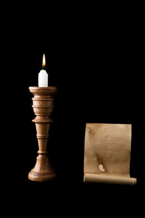 candle and old letter on a black background photo
