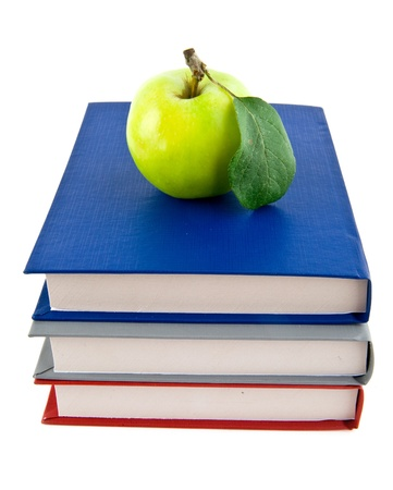 books and apple on a white background  Stock Photo