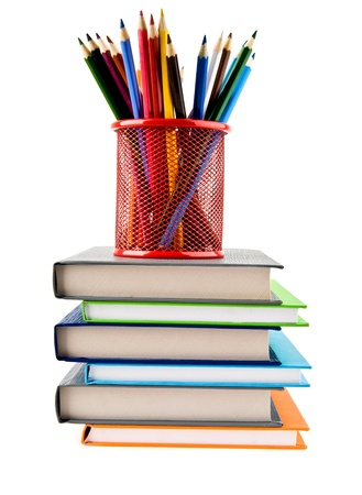 pencils and books on a white background Stock Photo - 15632674