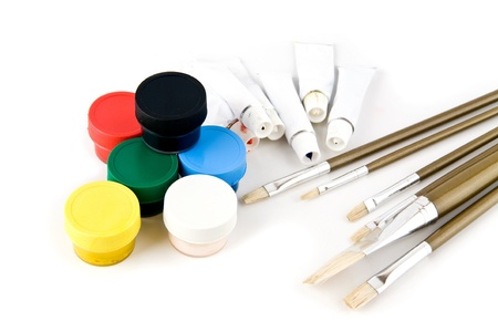 brushes and paints on a white background  photo