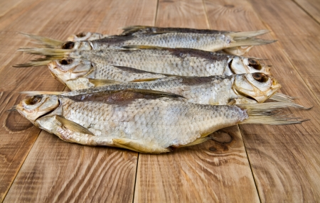 dry provisions: dried fish on a wooden table