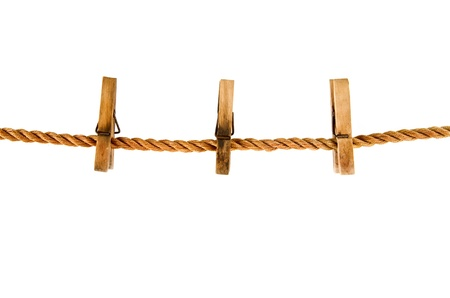 clothespins on a rope isolated on the white background Banque d'images