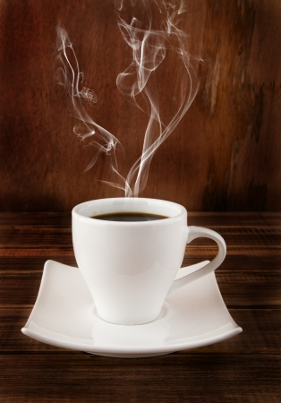 fragrant cup of coffee on a wooden background
