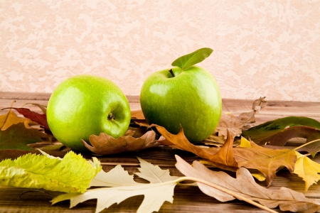 apples and leaves on a wooden table  photo
