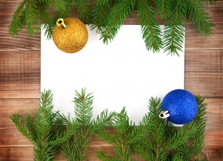 hristmas: �hristmas decoration with greeting card isolated on wooden background Stock Photo