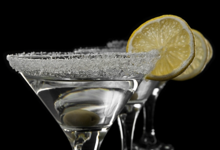 glasses of martini on a black background