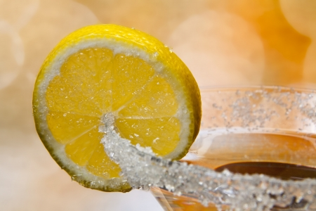 sweet vermouth: martini glass with lemon at the abstract background