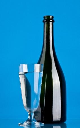 wine on a blue background photo