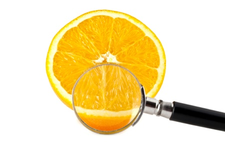 orange and a magnifying glass on a white background photo