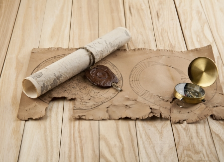 map and compass on a wooden background Stock Photo - 15746828