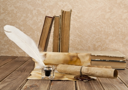 old books and pen on a wooden table Stock Photo - 15746831
